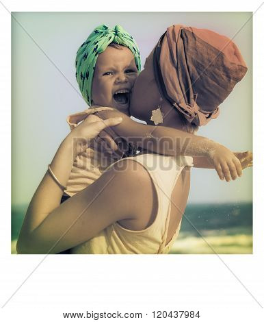 Young Mother Hugging Her Daughter On Beach. Happiness And Emotions Concept.