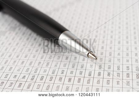 Black Ballpoint Pen On The Digital Table