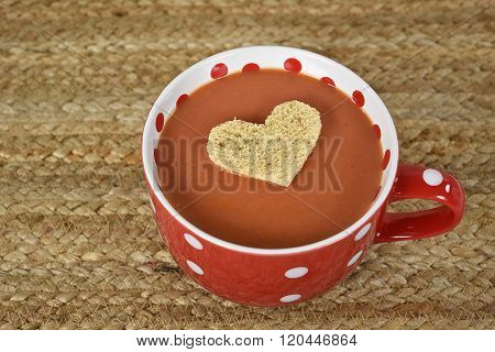 heart floating in tomato soup