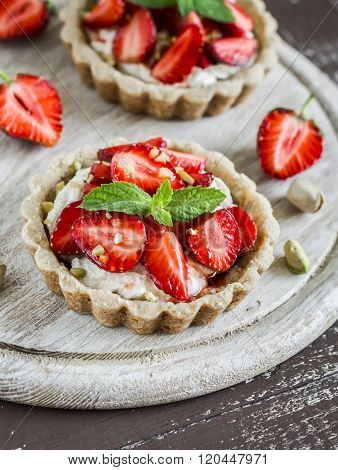 Strawberry Tartlet With Vanilla Cream On A Light Rustic Wooden Board. Sweet Delicious Summer Dessert