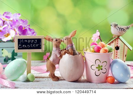 Easter Card With Kissing Rabbits And Decorations On Spring Background