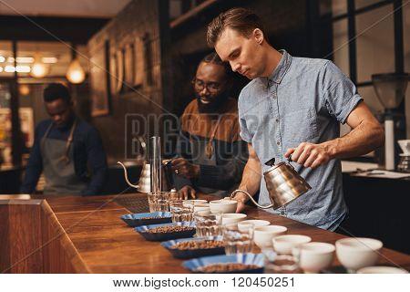 Baristas preparing a coffee tasting in modern roastery