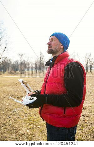 Bearded Man Controls Drone In Park.