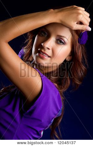 Beautiful latin woman wearing purple