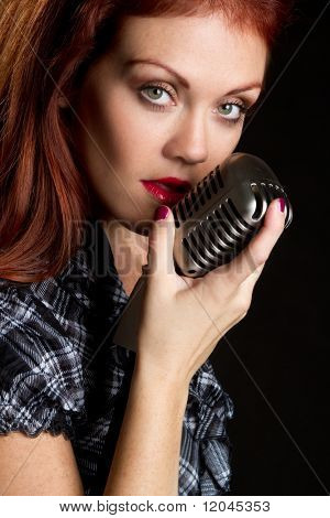 Woman singer with vintage microphone