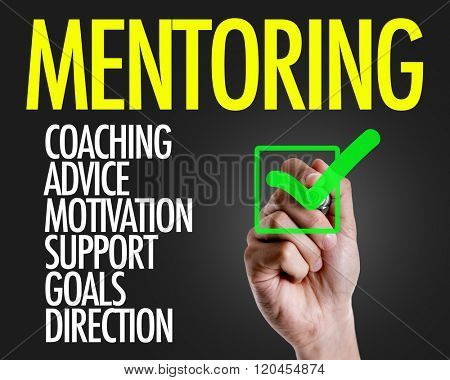 Hand writing the text: Mentoring Description