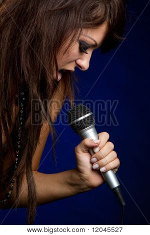 Beautiful microphone singing rockstar girl
