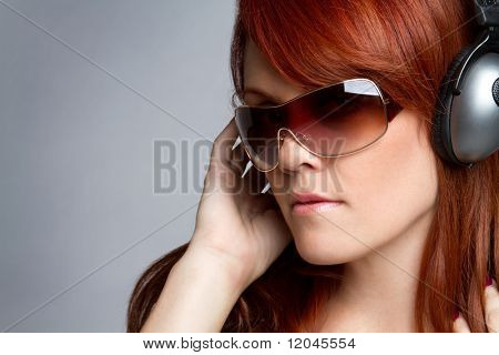 Beautiful redhead headphones music girl