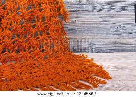 Knitted Woolen Female Shawl On Wooden Background