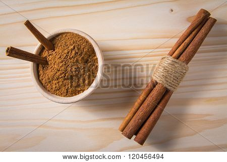 cinnamon in wooden bowl