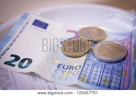 Twenty Euros Banknote And Coin