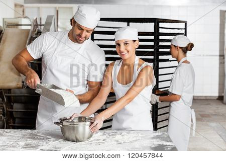 Baker's Working Together In Bakery