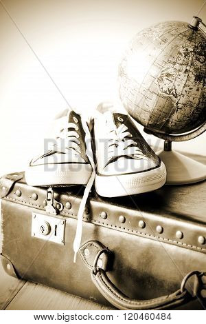 Old retro holiday suitcase and shoes for globetrotter