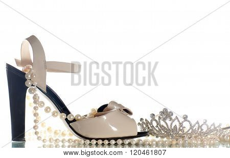 Sandals And Diadem On A White