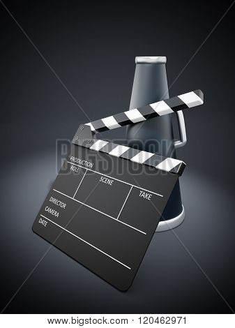 Clapboard And Bullhorn On Black Background