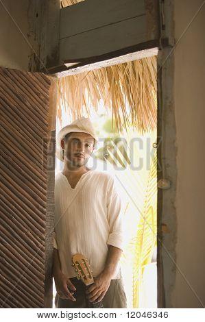 Young man standing in a doorway