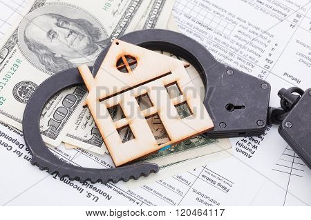 Money And Wooden House On Tax Form Background
