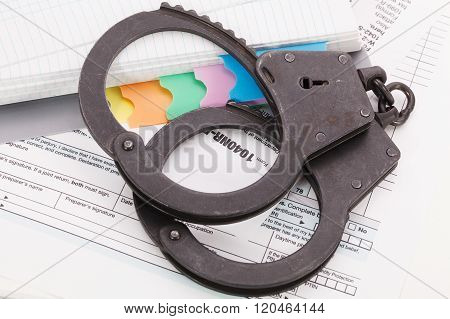 Handcuffs On Tax Form Background