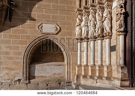 Apostles statues placed on the left side of the Evora Cathedral Portal in Portugal. Romanesque and Gothic architecture. UNESCO World Heritage Site.