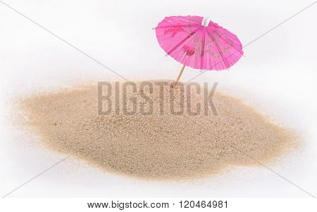 Cocktail Umbrella In Sand On A White