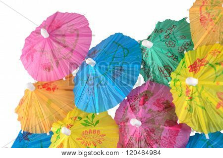 Colorful Paper Cocktail Umbrella Close-up On A White