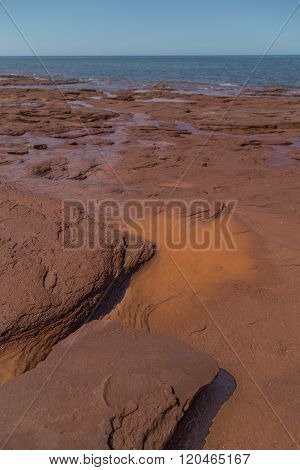Orange Layered Rock At Cavendish Beach