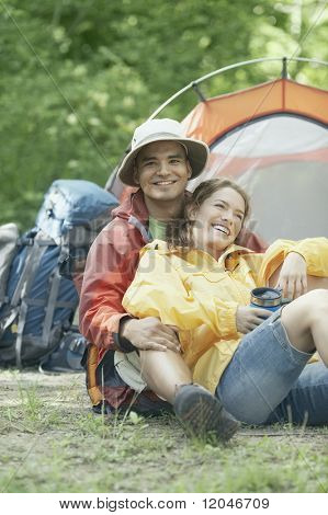 Couple embracing at their campsite