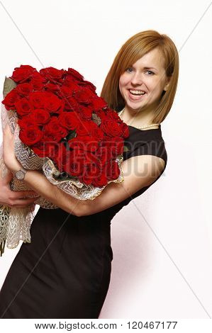 Beautiful young smiling blonde with roses