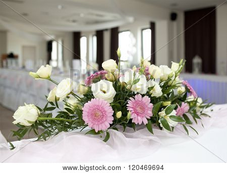 Wedding table with bouquet of gerbera flowers