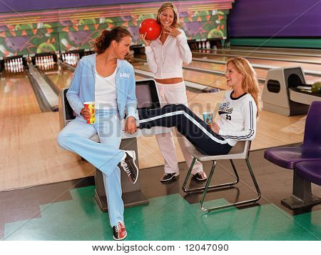 Young women relaxing at bowling alley
