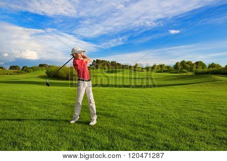 Boy playing golf