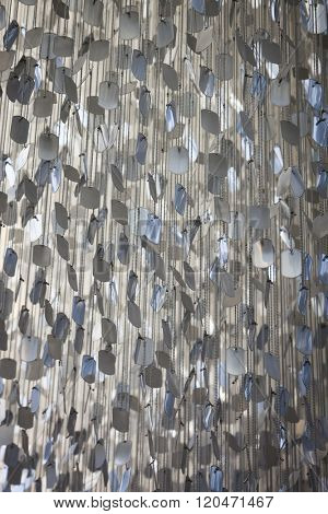 FAYETTEVILLE, NC - JUNE 28, 2015: 33,500 blank replica dog tags strung on strands of ball chain resemble a giant chandelier hanging in the Visitors Center in the North Carolina Veterans Park.