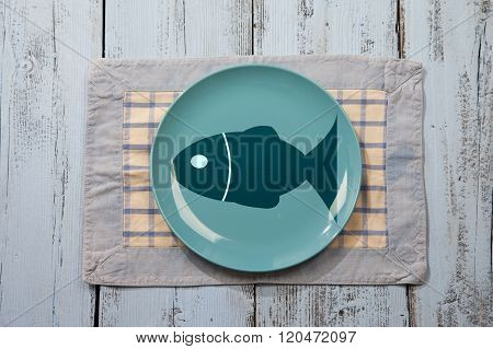 Empty Plate With Fish Illustration On Light Blue Wooden Background