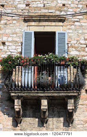 Medieval balcony with flowers