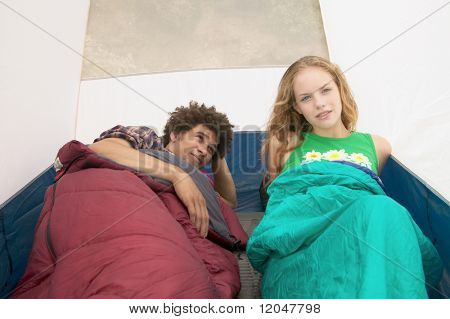 Young couple sleeping in tent