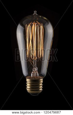 Vintage Light Bulb on Black Background