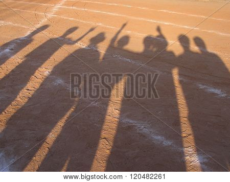 shadow of runner on racetrack