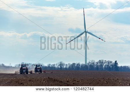 Aerial View On The Windmill And The Tractors