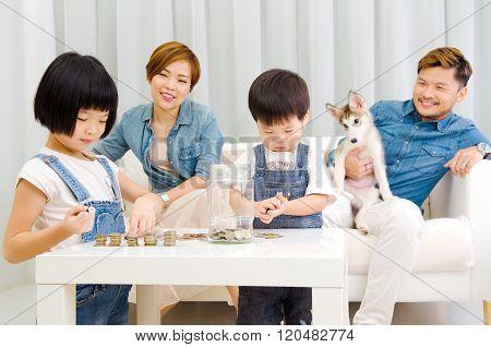 Asian kids cointing money. Money saving concept.