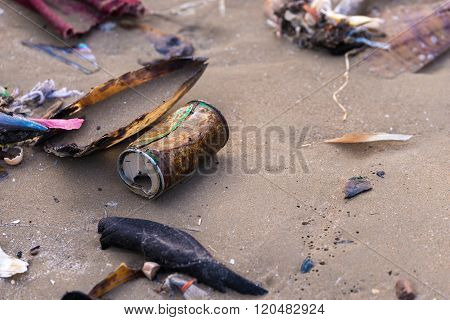 Beach pollution. Plastic bottles and other trash on sea beach.