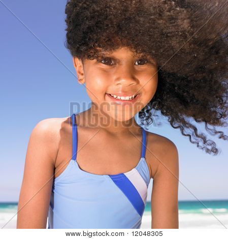 Girl smiling at beach