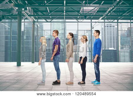 family, gender, high and people concept - group of men and women from side over terminal with window city view background