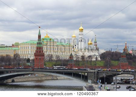 View of the Grand Kremlin Palace and the Cathedral of the Annunciation cloudy day in april. The Mosc