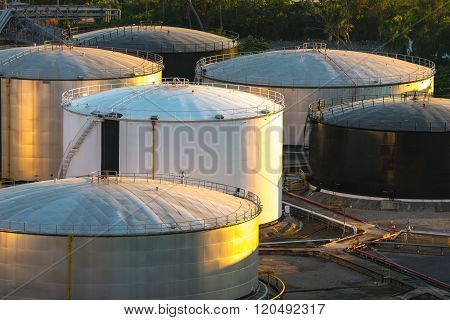 Oil storage tank in petrochemical refinery industry, heavy industrial plant