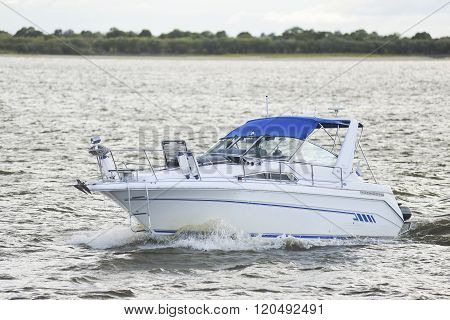Motor Boat Floats On The River