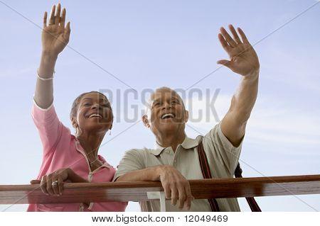 Couple waving goodbye