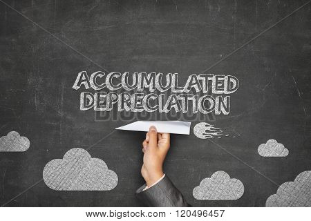 Accumulated depreciation concept on blackboard with paper plane