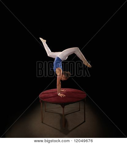 Gymnast balancing on a table