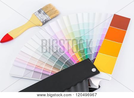 Color chart guide for renovation with brush on white background