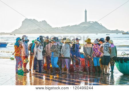 Fishermen gather fish market inside the coastal fishing village